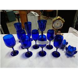 FIGURAL CLOCK AND BLUE GLASSES AND CANDLE STICKS