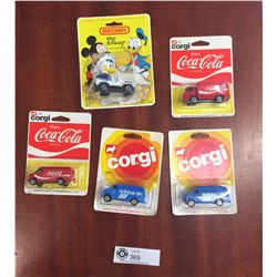 4 New in the Package 1978 Cirgu Cars. Coca Cola and Adidas and a 1979 Matchbox Donald Duck in a Jeep