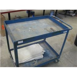 USED METAL BLUE CART ON ROLLERS