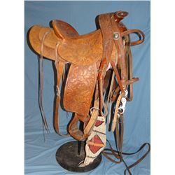 Ray Holes, (Grangeville, Idaho)  saddle, fancy flower tooled w/matching silver mtd bridle