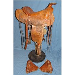 Ray Holes stock saddle, horsehead carving on fenders, ca 1943