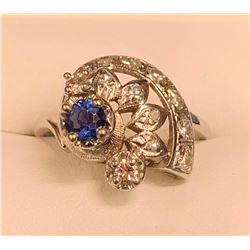 Yogo sapphire ladies ring, .33 ct round brilliant Yogo and 13 diamonds in 14kt white gold setting. S