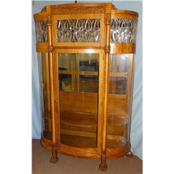 Fancy oak curved glass china cabinet w/ leaded glass, claw feet, wooden shelves, mirrored back, 74""