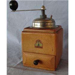 Wooden coffee grinder, arm in trosser