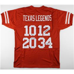 Jersey signed by (4) Colt McCoy, Vince Young, Ricky Williams,  Earl Campbell (JSA COA)
