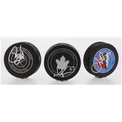 Lot of (3) Signed Logo Hockey Pucks With Phil Housley, Joe Nieuwendyk  Darryl Sittler (Beckett COA)