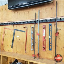 Group of 9 Tools (Framing Squares, Crow Bar, Levels, Pipe Clamps)