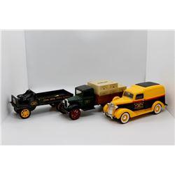 3 John Deere trucks