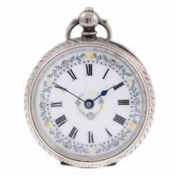 An open face pocket watch. White metal case, stamped
