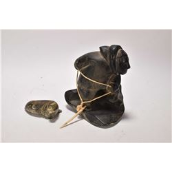 "Carved two piece soapstone figure of a fisherman with harpooned seal, 6 1/2"" in height and signed on"
