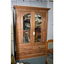 Antique style two door hand carved wardrobe with bevelled glass panels and three drawer base