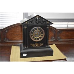 Antique slate mantle clock with Roman numeral dial and Corinthian column, movement working at time o