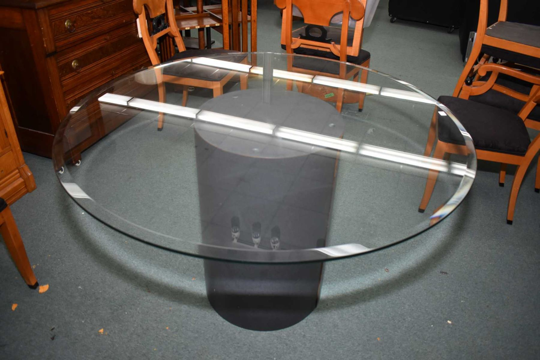Modern round glass top dining table on drum pedestal