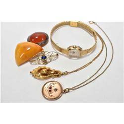 Selection of vintage jewellery including carnelian brooch, amber brooch, Caravelle vintage watch, an