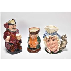 Three Royal Doulton jugs including The Cook and the Cheshire Cat, Falstaff and the Squire