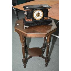 "Antique faux slate chiming ""Wm. L. Gilbert"" mantle clock with cast feet and lion's head decoration,"