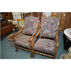 Two matching open arm William & Mary style parlour chairs with tapestry upholstery, one with male ca