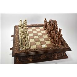 Large resin chess board with two drawers representing the Spanish Conquest of the Aztec empire with