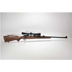 "Non-Restricted rifle Winchester model 70, 300 Win Mag. mag fed bolt action, w/ bbl length 24"" [Blued"