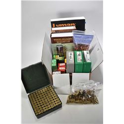 Selection of reloading manuals, 100 rounds of .45 Colt brass in plastic case, 49 rounds of .45 brass