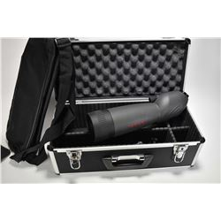 A Tasco 20 40X60 spotting scope with tri-pod, soft and hard case. Hoppe's shooting rest and a possib
