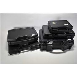Five assorted plastic pistol cases.