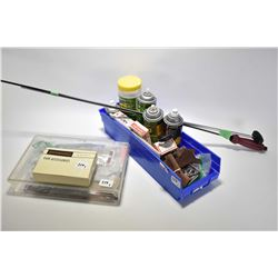 Selection of firearms accessories including cleaning solvents, cleaning rods, pistol grips, target p