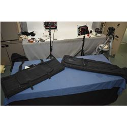 Two soft black rifle cases with storage pouches.