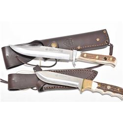 Two Puma knives including Wildcat Stag 816300 with leather scabbard and Original Bowie 116396 with s