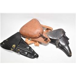 Three vintage flap holsters including leather Hannover Luger, black leather holster with two magazin