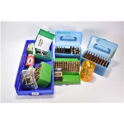 Selection of reloads and accessories including blue container with 18 count 7mm Rem mag reloads and