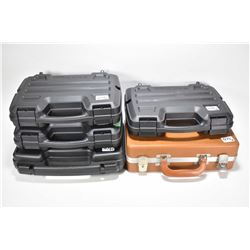 Five hard pistol cases including four black and one tan.