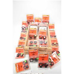 Wooden crate containing approximately 27 new in package scope rings with assorted fittment.