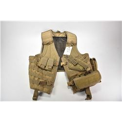 Tactical webbed vest with holster and pouches.