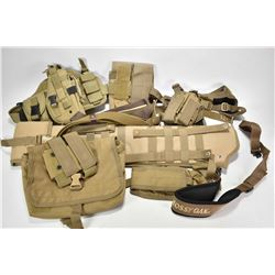 Selection of green/tan tactical gear including rifle scabbard, slings, mag pouches, holster etc.