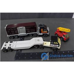 (2) Tonka Semi's - One Flat Deck; One Cattle Liner & Tonka Ladder Truck