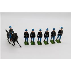 Soldiers in Black Coats and Helmets, Blue Pants, 1 Horse