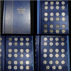 Near Complete Jefferson Nickel book 1938- 1964 69 coins . .