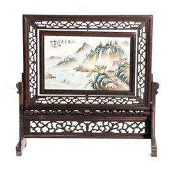 Framed Chinese landscape painted on porcelain.