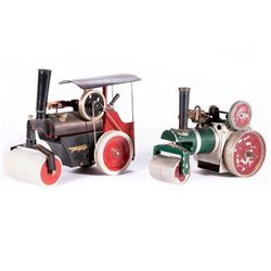 Two vintage steam roller toys.
