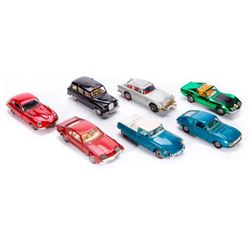 Seven Corgi toy cars.
