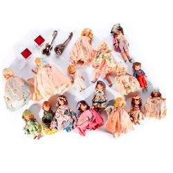 Group of dolls plus two instruments.