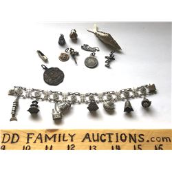 SILVER CHARM BRACELET WITH ADDITIONAL CHARMS