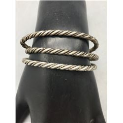 Group of Three Twisted Wire Bracelets