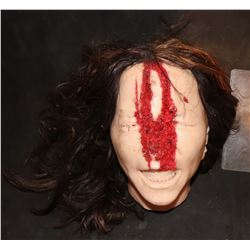 SEVERED SILICONE FEMALE HEAD WITH HAIR AND GORE