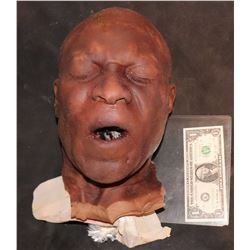 SEVERED SILICONE BLACK MAN HEAD WITH MOUTH OPEN MICHAEL CLARK DUNCAN?