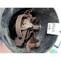 lot of two pails with number 3 and number 4 traps
