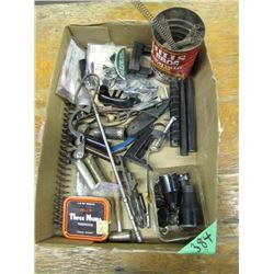 box of assorted gun parts
