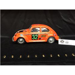 1960's Japan Friction VW Bug Car Orange with Stickers. Battery Operated