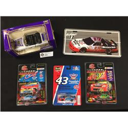 Racing Car Lot. 1955 Cheverolet Die Cast Bank New In Box. 3 Smaller Nascar Cars. New in Package. Plu
